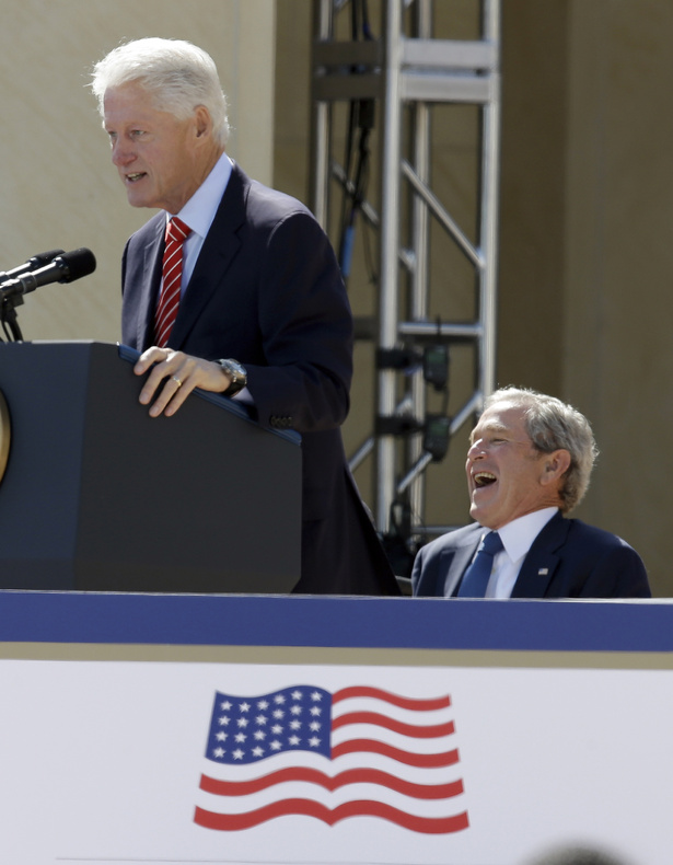 Former President George W. Bush laughs as former President Bill Clinton speaks at the dedication of the George W. Bush Presidential Center on Thursday in Dallas.