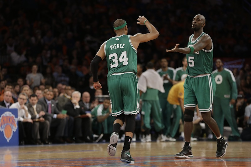 Boston Celtics forward Paul Pierce (34) and Celtics center Kevin Garnett (5) react in the second half of Game 1 of the NBA basketball playoffs in New York, Saturday, April 20, 2013. (AP Photo/Kathy Willens)