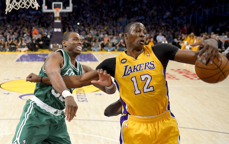 Boston Celtics center Jason Collins battles Los Angeles Lakers center Dwight Howard (12) for a rebound during the first half of their NBA basketball game, Wednesday, Feb. 20, 2013 in Los Angeles. NBA veteran center Collins has become the first male professional athlete in the major four American sports leagues to come out as gay. Collins wrote a first-person account posted Monday, April 29, 2013 on Sports Illustrated's website. (AP Photo/Mark J. Terrill, File)