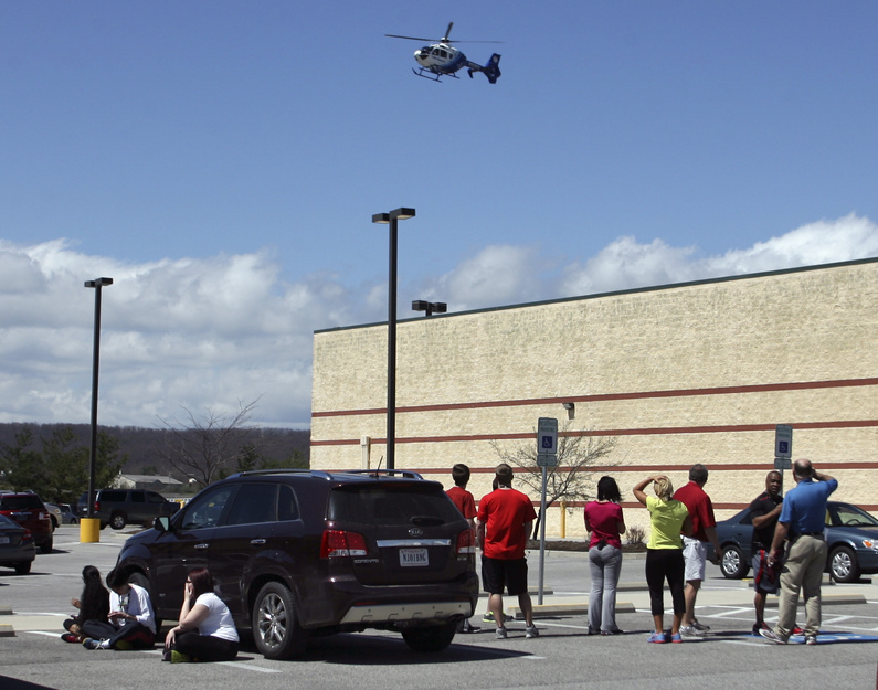 A medical helicopter approaches a parking lot outside the New River Valley Mall in Christiansburg, Va., on Friday after two women were shot there.