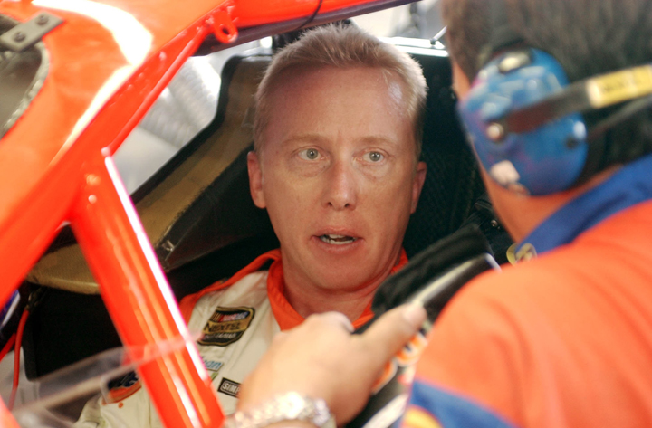 In this 2004 photo, NASCAR driver Ricky Craven talks before practice for the Nextel Cup Siemens 300 at New Hampshire International Speedway in Loudon, N.H.