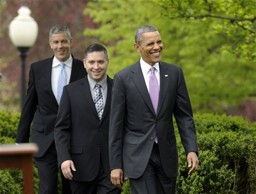 2013 National Teacher of the Year Jeff Charbonneau, center, follows President Barack Obama to the Rose Garden for a ceremony honoring Charbonneau. Education Secretary Arne Duncan at left.