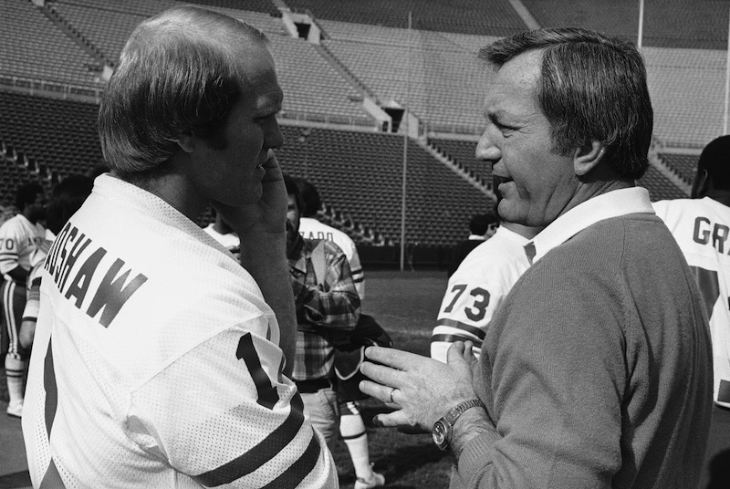 In this Jan. 23, 1979 file photo, Pittsburgh Steelers quarterback Terry Bradshaw, left, talks with New England Patriots coach Chuck Fairbanks prior to the Pro Bowl football game in Los Angeles. Fairbanks, who coached Heisman Trophy winner Steve Owens at Oklahoma and spent six seasons as coach of the New England Patriots, died Tuesday, April 2, 2013, in Scottsdale, Ariz., after battling brain cancer, the University of Oklahoma said in a news release. He was 79. (AP Photo/Wally Fong) football;player;pro;professional;sports