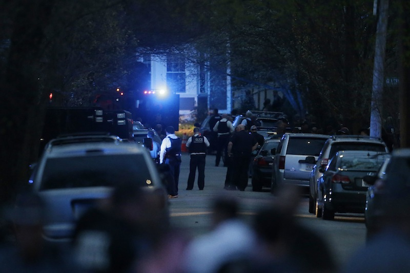 Law enforcement search for the suspect in the Boston Marathon bombings, Friday, April 19, 2013, in Watertown, Mass. Gunfire erupted Friday night amid the manhunt for the surviving suspect in the Boston Marathon bombing, and police in armored vehicles and tactical gear rushed into the Watertown neighborhood in a possible break in the case. (AP Photo/Matt Rourke)