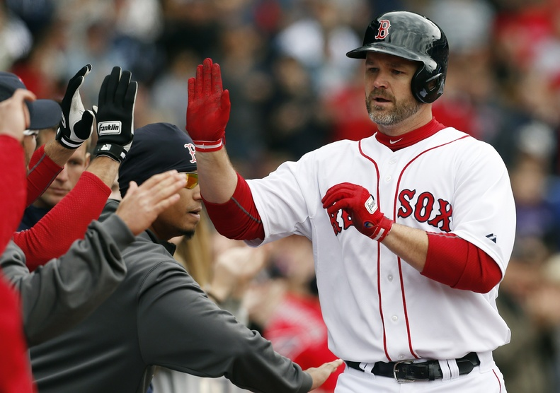 David Ross celebrates his solo home run in the fifth inning against the Tampa Bay Rays in Boston on Saturday.