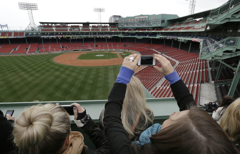 Fans shoot photos from the Green Monster seats during a tour of Fenway Park in Boston Friday, April 5, 2013. The Boston Red Sox baseball home opener is scheduled for Monday against the Baltimore Orioles. (AP Photo/Elise Amendola)