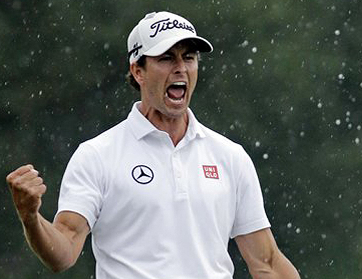 Adam Scott, of Australia, celebrates after a birdie putt on the 18th green during the fourth round of the Masters golf tournament Sunday in Augusta, Ga. Scott won the tournament in a playoff round with Angel Cabrera.