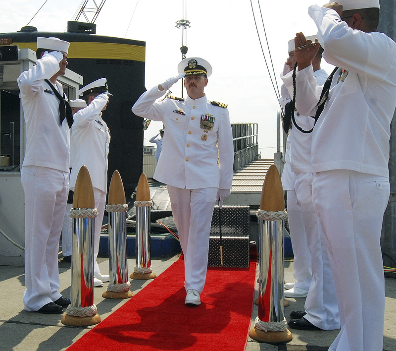 U.S. Navy Cmdr. Michael P. Ward II, center, is saluted during the change-of-command ceremony for the nuclear submarine USS Pittsburgh at the Naval Submarine Base New London, in Groton, Conn., in August 2012.