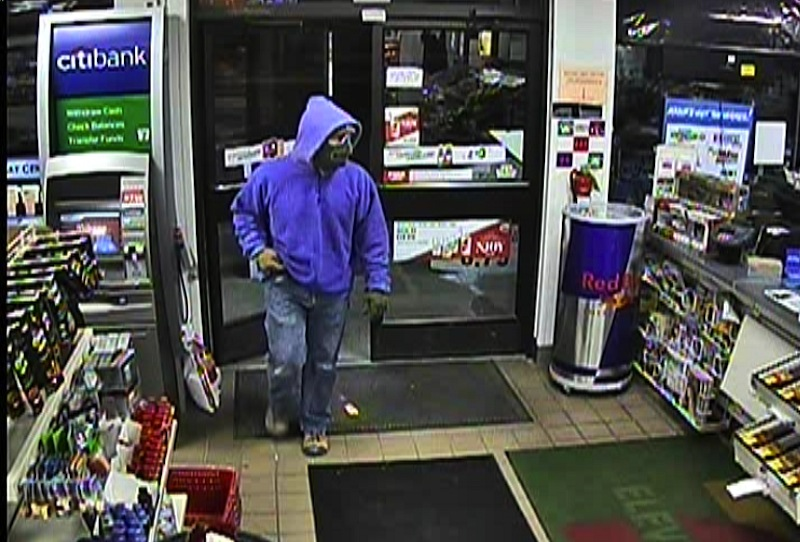 This surveillance-camera image shows a suspect robbing the 7-Eleven in Springvale on the night of Feb. 5.