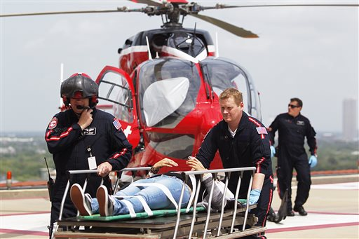 Emergency personnel rush a victim to a LifeFlight helicopter after a stabbing attack on the Lone Star Community College System's Cypress, Texas, campus on Tuesday.