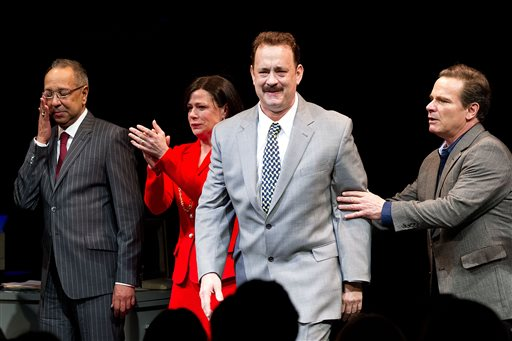 George C. Wolfe, left, Maura Tierney, Tom Hanks and Peter Scolari perform in
