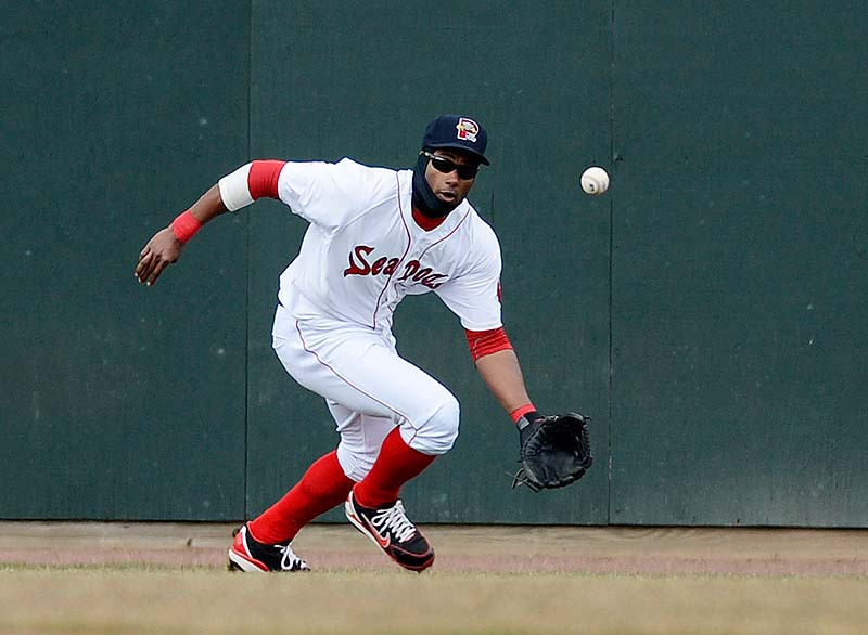 Left fielder Tony Thomas of the Sea Dogs fields a hit against the Trenton Thunder Sunday at Hadlock Field. Portland lost, 9-7.