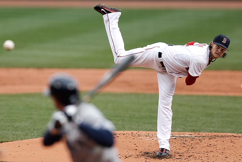 Clay Buchholz throws a pitch against the Tampa Bay Rays Sunday at Fenway Park.