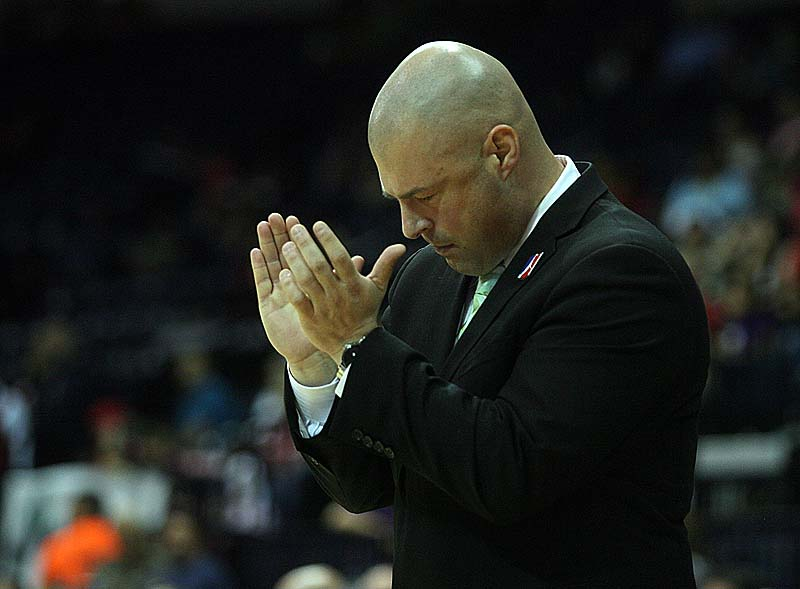 Claws Coach Mike Taylor cheers on the team in Saturday night's layoff game. The Claws were ousted by the Vipers, 98-97.