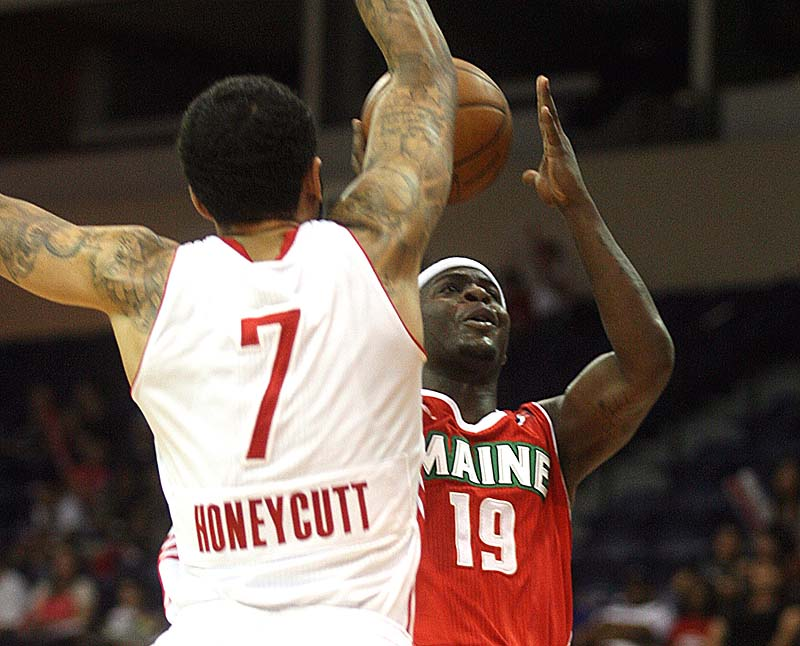 Josh Selby of the Maine Red Claws takes the ball to the basket Saturday night against Tyler Honeycutt of the Rio Grande Valley Vipers. The Claws were eliminated, 98-97.