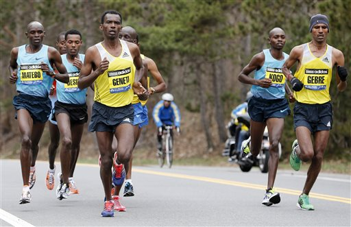 Elite mens marathoners, from left, Levy Matebo, Lelisa Desisa, Markos Geneti, Micah Kogo and Gebregziabher Gebremariam compete on the Boston Marathon course in Wellesley, Mass., Monday, April 15, 2013. (AP Photo/Michael Dwyer)