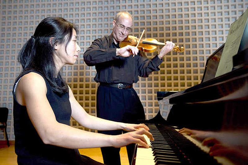 Pianist Chiharu Naruse and violinist Dean Stein perform on Friday at the Olin Arts Center on the campus of Bates College in Lewiston. bates college lewiston maine