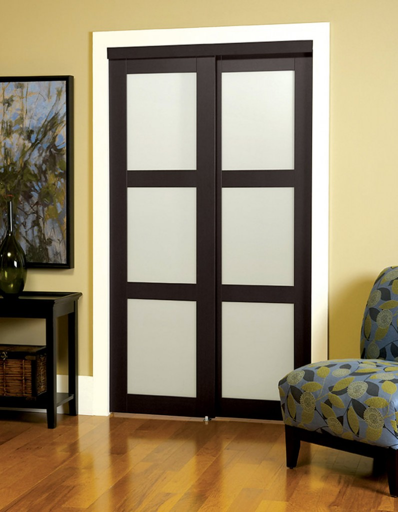 An interior sliding door from Lowe's with tempered frosted glass panes.