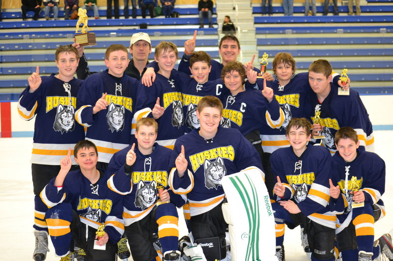 Members of the Huskies Blues bantam hockey team, which recently won the Casco Bay Hockey Tournament in Biddeford: Front (from left to right) – Elijah Gosselin, Darren Puckett, Kyle McKay, Doug Brooks and Jacob Picard; middle – Devin Sloan, Anthony Morrison, Sam Jacob, Tom Komulainen, Gage Chenard, Dylan Francoeur and David Redmond; back –Coach Jake Jacob and Chris Lekousi.