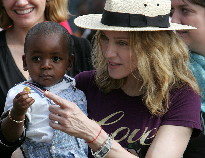 Pop singer Madonna carries her son, David Banda, in April 2007 while visiting Malawi. She has adopted two children from the country.