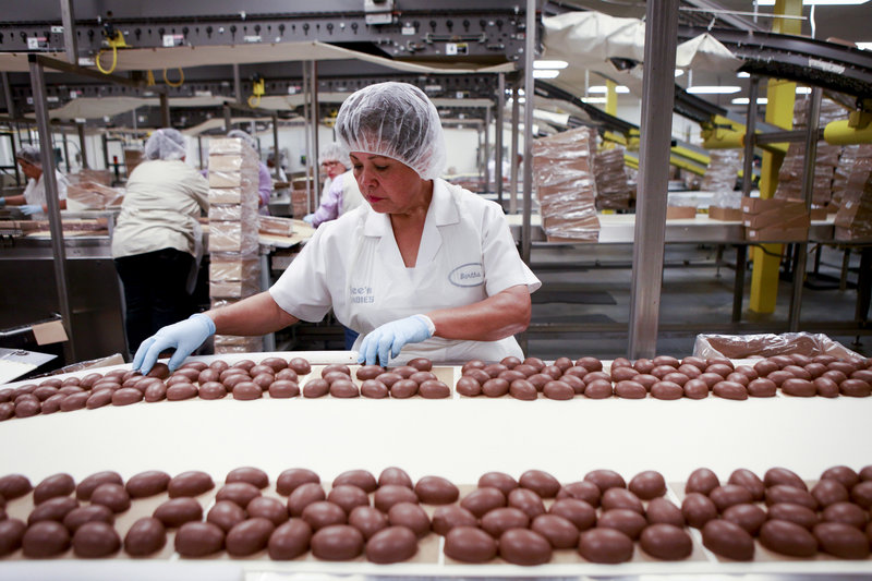 Bertha Ramos sorts freshly coated chocolate marshmallow eggs at a See's Candies factory in Los Angeles.