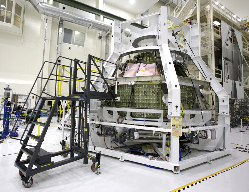 The Orion Exploration Flight Test 1 crew module is seen in the Operations and Checkout Building at the Kennedy Space Center in Cape Canaveral, Fla., during a media tour earlier this year.