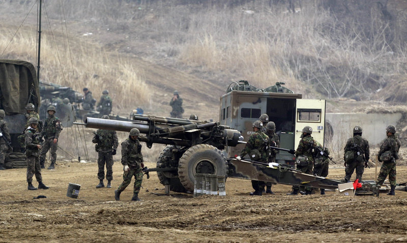 South Korean Army K-55 self-propelled howitzers are deployed during their military exercise in the border city between two Koreas, Paju, north of Seoul, South Korea on Friday. After a series of escalating threats, North Korea has moved a missile with