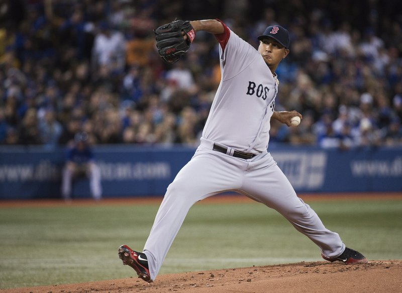 Boston Red Sox starting pitcher Felix Doubront works against the Toronto Blue Jays in the first inning in Toronto on Friday.