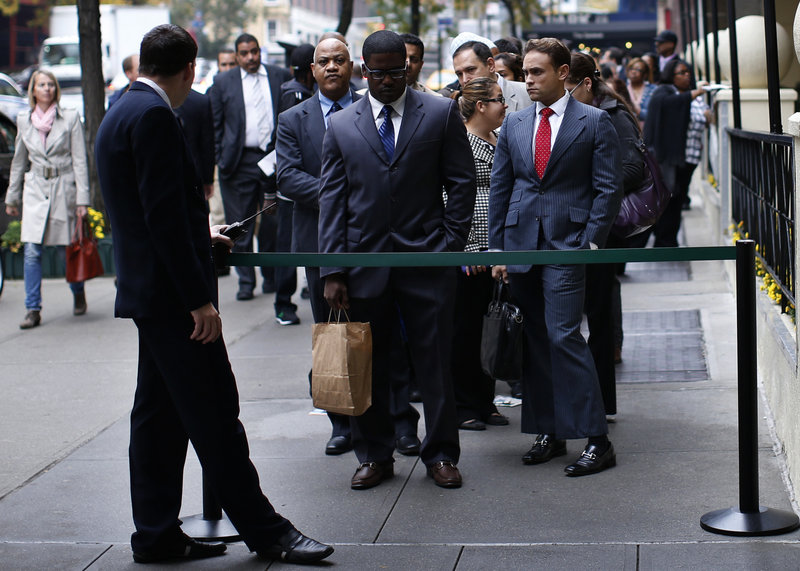 Job seekers wait to meet with prospective employers at a career fair in New York City last October. The percentage of working-age adults in the U.S. labor force – the participation rate – fell to 63.3 percent last month, the lowest such figure since 1979.