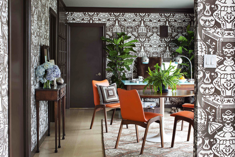 Designer Brian Patrick Flynn incorporated life and serenity into this home office with a pair of fiddle leaf ficus trees and a large, low-maintenance fern.