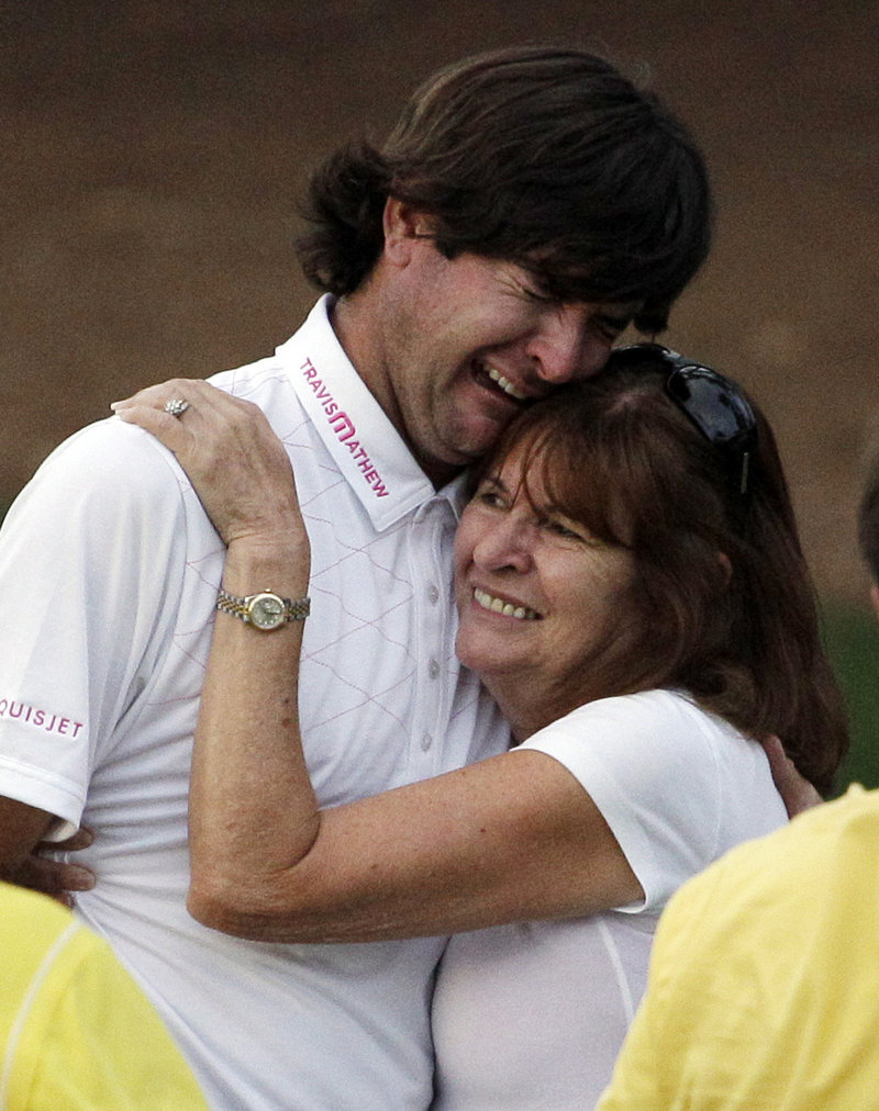 Molly Marie Watson proudly hugs her son, Bubba Watson, after he won the 2012 Masters, partially due to a perfect wedge shot from pine straw on the 10th hole to save par.