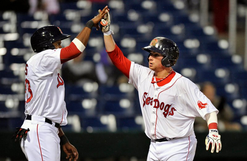 Christian Vazquez of the Sea Dogs, right, is welcomed by teammate Tony Thomas after hitting a three-run homer in the sixth inning.