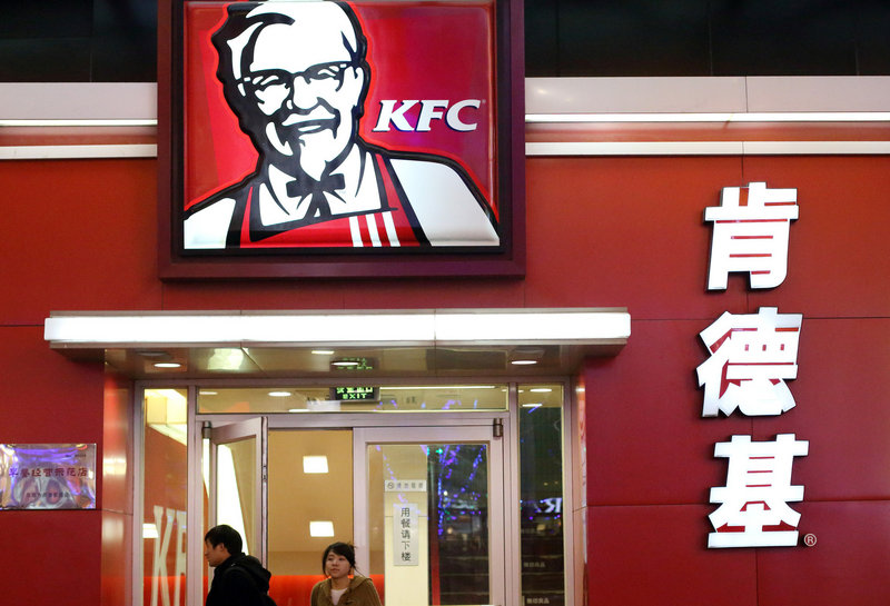 A couple leave a KFC outlet in Beijing. Health experts say the proliferation of fast-food restaurants is partly to blame for increases in heart diseases and diabetes in China and other countries.
