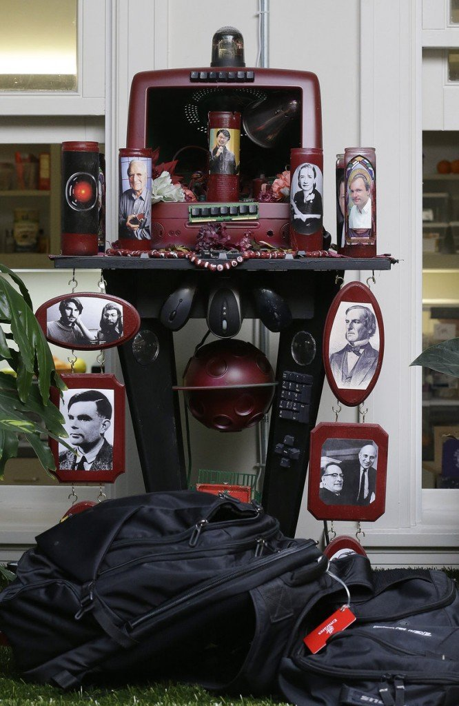 A shrine with photos of Steve Jobs, Steve Wozniak, Craig Barrett and others is shown at the Dev Bootcamp office in San Francisco.