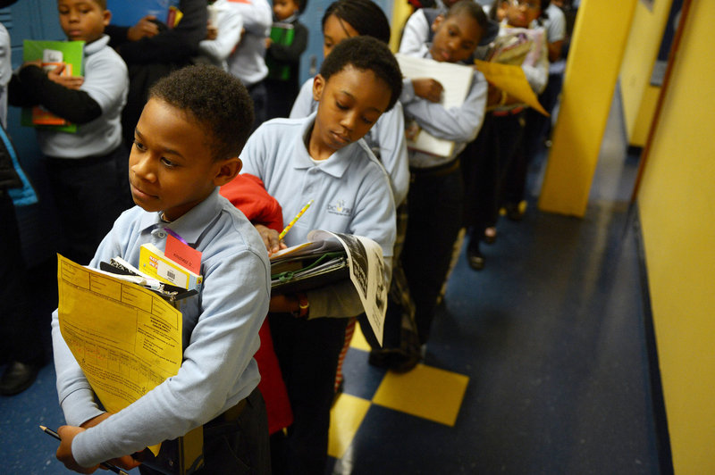 Christopher Rios, left, and Kenneth Scott line up at D.C. Prep in Washington, which places an emphasis on teaching children self-control.