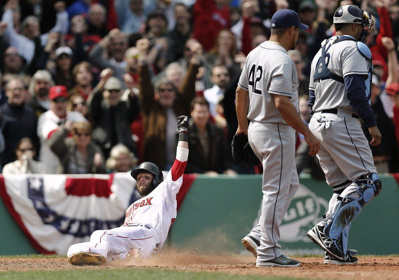 Dustin Pedroia slides home with the winning run on a double by teammate Mike Napoli as Tampa Bay pitcher Joel Peralta and catcher Jose Lobaton walk away.