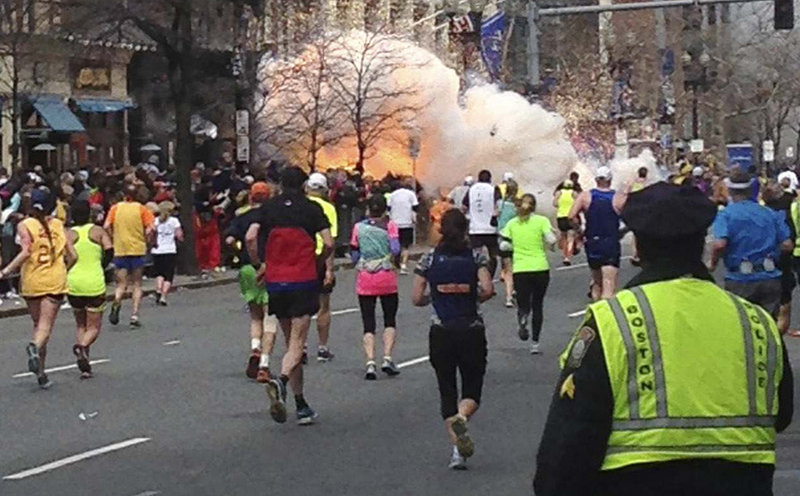 Runners approach the finish line of the Boston Marathon just as an explosion erupts Monday, one of two that took place about 10 seconds and about 100 yards apart. The blasts knocked spectators and at least one runner off their feet, shattered windows and sent dense plumes of smoke rising over the street. As many as two unexploded bombs also were found near the end of the 26.2-mile course as part of what appeared to be a well-coordinated attack, but they were safely disarmed, said a senior U.S. intelligence official.