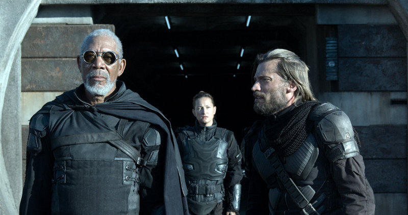 "Morgan Freeman, left, Andrea Riseborough and Nikolaj Coster-Waldau in the post-apocalyptic world of ""Oblivion."""