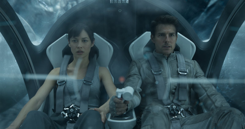 "Olga Kurylenko, left, plays an astronaut who may have a past with Jack Harper, played by Tom Cruise, in ""Oblivion."""