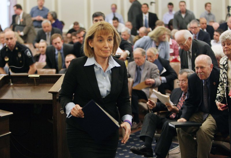 Gov. Maggie Hassan, D-N.H., leaves a joint House panel public hearing Tuesday, April 16, 2013 at the Statehouse in Concord, N.H., after urging them to pass a bill to license a single casino in New Hampshire. Hassan urged the House on Tuesday not to let Massachusetts benefit from casino revenues that could help New Hampshire pay for vital services without raising taxes. (AP Photo/Jim Cole)