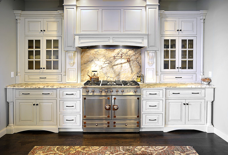 Cabinets surrounding a marble backsplash and a new La Cornue range are located where the baptismal font used to be in the former church overlooking Payson Park.