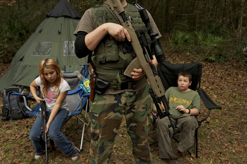 "Members of the North Florida Survival Group are seen prior to a field training exercise in Old Town, Florida. The group is a staunch supporter of the right to bear arms and aims to teach ""patriots to survive in order to protect and defend our Constitution against all enemy threats."""
