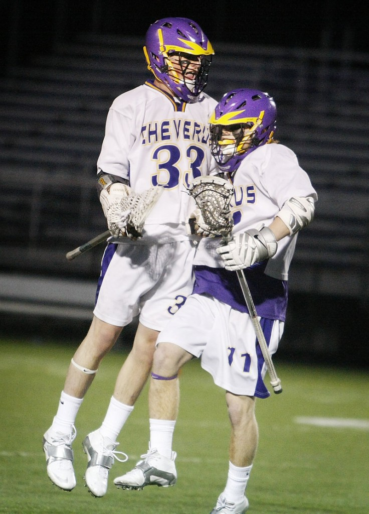 Patrick Sullivan, left, and Jack Sutton of Cheverus celebrate Sutton's goal in the first quarter. Cheverus led 3-0 at halftime, Thornton rallied to tie, then Cheverus regained control.