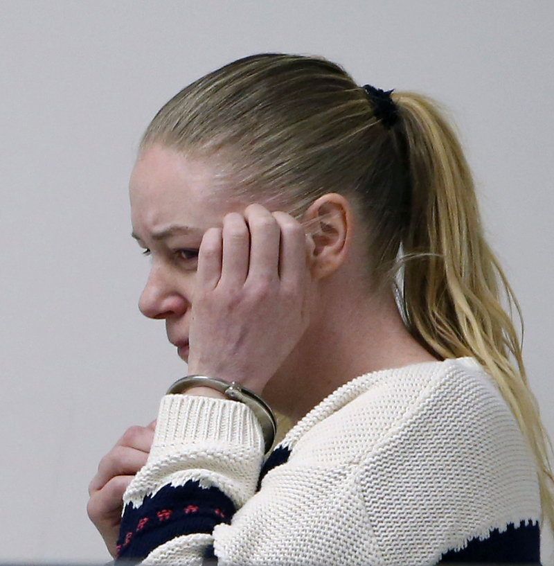 Irish nanny Aisling McCarthy Brady weeps at Middlesex Superior Court, Thursday, April 18, 2013, in Woburn, Mass. Brady is accused of violently injuring and killing a baby in her care and was indicted on a murder charge on Friday. (AP Photo/Bizuayehu Tesfaye, Pool)
