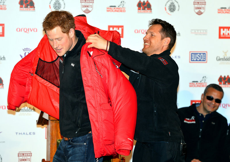 Prince Harry is presented a red thermal coat Friday during the launch of the Walking With The Wounded South Pole Allied Challenge 2013.