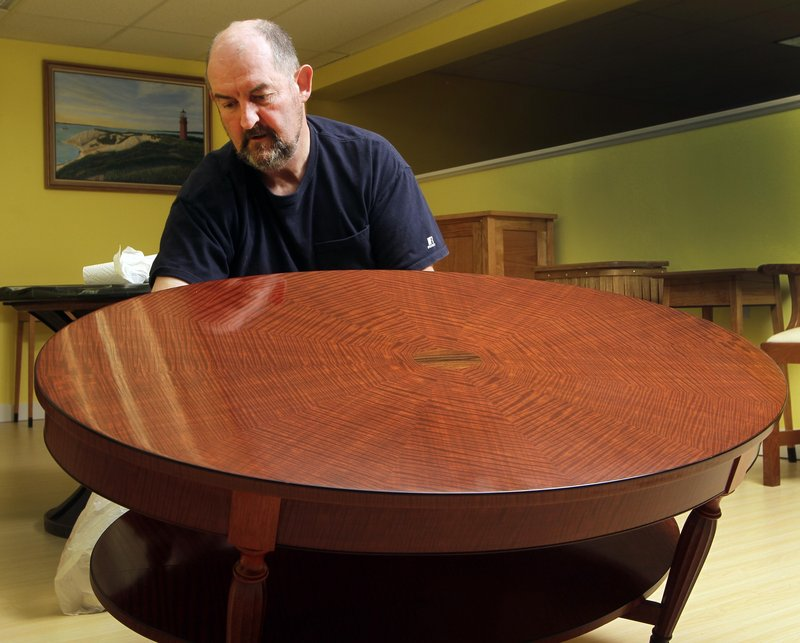 Terry Moore, a master furniture maker, has been teaching convicts at the New Hampshire state prison his craft for nearly 13 years. The inmates' work will be featured alongside Moore's in an exhibit at Grevior Furniture.