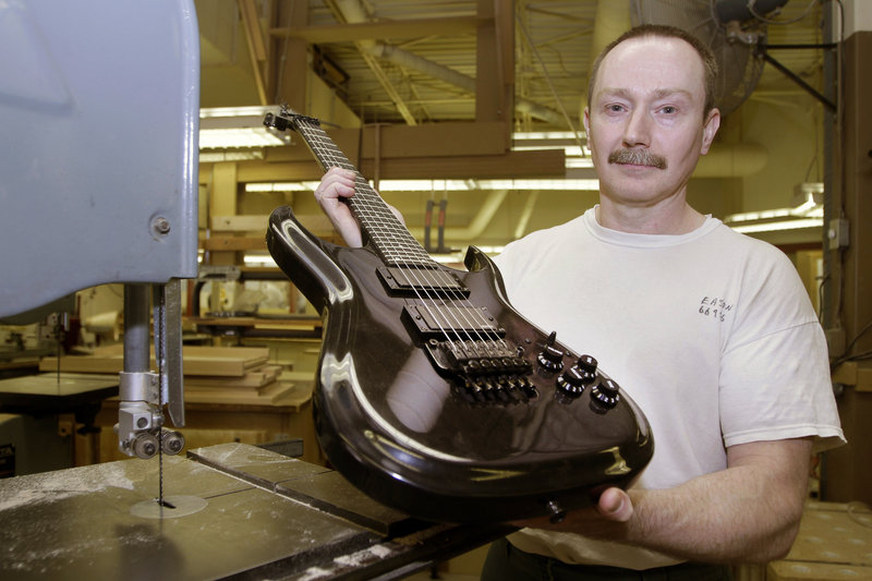 "Allen Eason poses with a guitar he made. Eason is a master furniture maker and a convicted murderer without the possibility of parole. ""This is my life,"" Eason said."