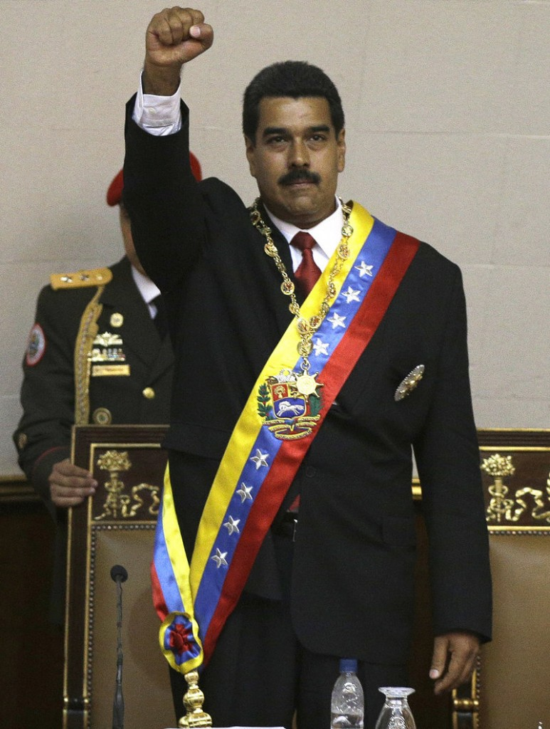 Nicolas Maduro salutes before delivering his inaugural speech at the National Assembly on Friday.