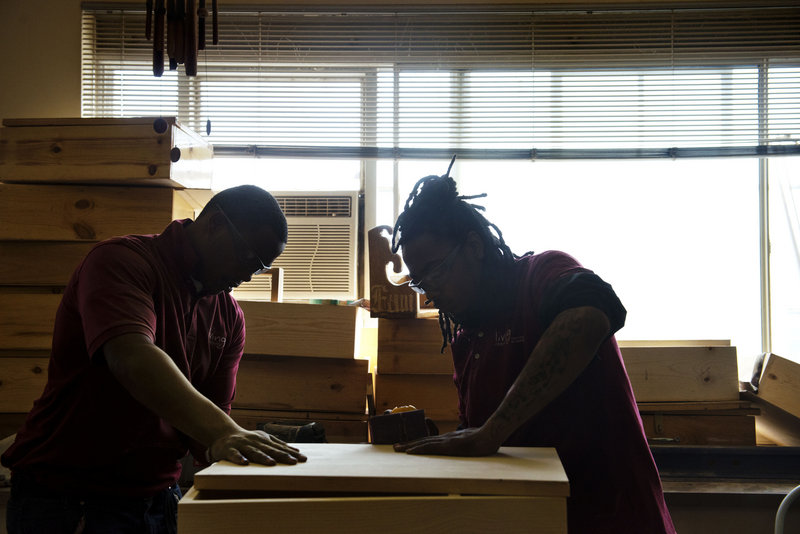 Students Terrence Sinclair, 18, and Kent Tucker, 17, study woodworking in the District of Columbia's Living Classrooms Program. The new GED exam that they will take should be a better measure of their capabilities.