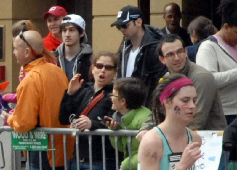 Dzhokhar Tsarnaev, wearing a white hat, stands next to Tamerlan Tsarnaev at the Boston Marathon in a picture taken 10 to 20 minutes before the blasts that killed three spectators.